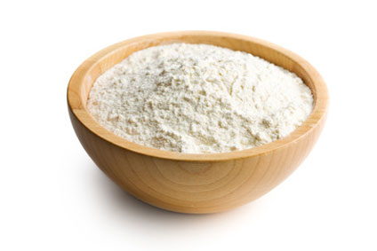 Coconut flour in wooden bowl