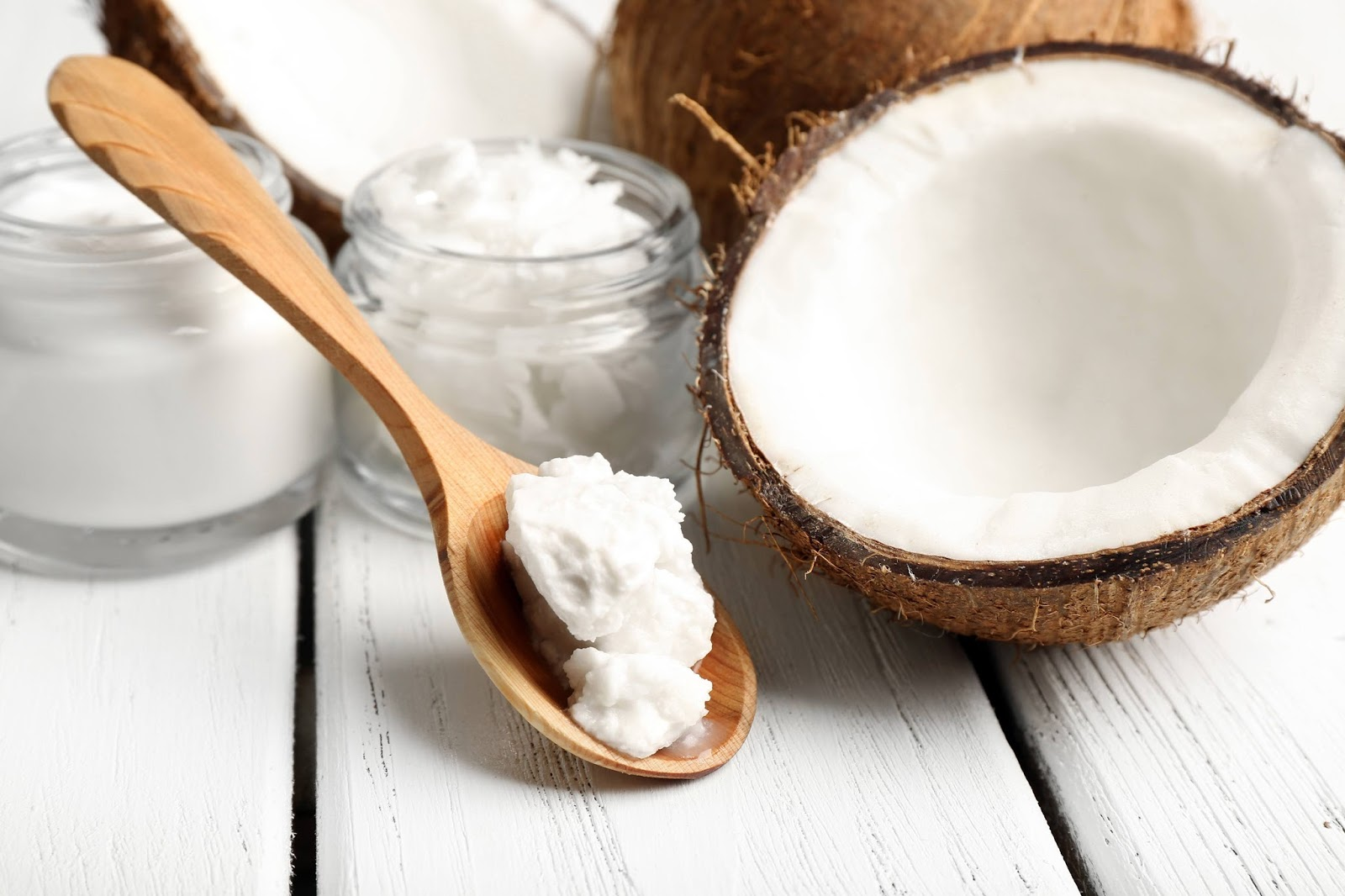 Creamed coconut on wooden spoon